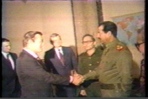 Donald Rumsfeld shaking hands with Saddam Hussein in 1983
